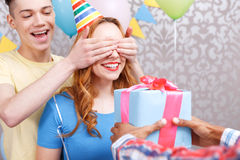 Young girls receiving presents at birthday party Royalty Free Stock Photography