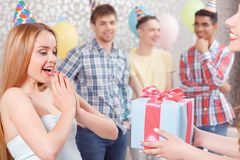 Young girls receiving presents at birthday party Royalty Free Stock Images