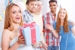 Young girls receiving presents at birthday party Stock Photography