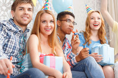 Young girls receiving presents at birthday party Stock Photos