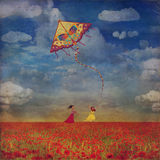 Young girls  among  the red poppies field  with  kite Stock Photography