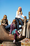 Young girls relaxing on the city street Royalty Free Stock Photo