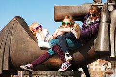 Young girls relaxing on the city street Royalty Free Stock Image