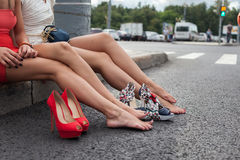 Young girls on roadside Stock Photography
