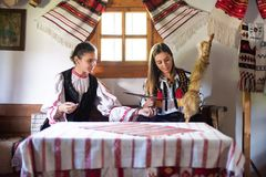 Young girls with Romanian traditional costume. Apuseni mountains , Alba county royalty free stock photos