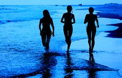Young Girls Running on Beach Royalty Free Stock Images