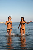 Young girls running on water Stock Image