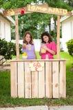 Young girls selling lemonade Stock Image