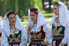 Young girls from Serbia in traditional costume. ROMANIA, TIMISOARA - JULY 10, 2016: Young girls from Serbia in traditional costume, present at the international stock photo