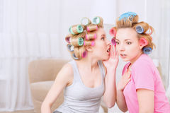 Young girls sharing secrets Stock Photos