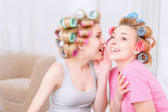 Young girls sharing secrets Stock Image
