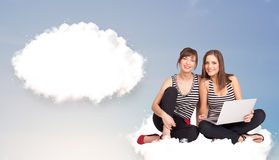 Young girls sitting on cloud and thinking of abstract speech bub Stock Image