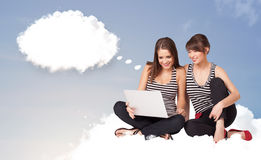 Young girls sitting on cloud and thinking of abstract speech bub Royalty Free Stock Images