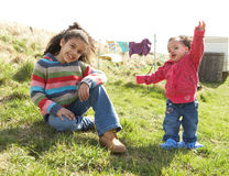 Young Girls Sitting Outside In Caravan Park Royalty Free Stock Photos