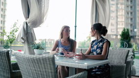 Young girls sitting in a restaurant. stock footage
