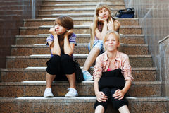 Teenage school girls sitting on the steps Stock Photo