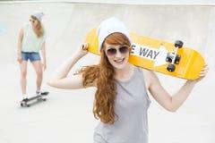 Young girls skateboarding royalty free stock photo