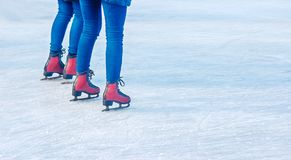 Young girls are skating. feet closeup. Two young girls are skating on the rink. feet closeup Royalty Free Stock Images