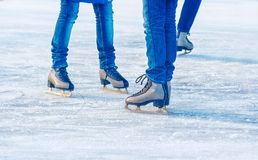 Young girls are skating. feet closeup. Young girls are skating on the rink. feet closeup Royalty Free Stock Images