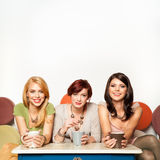 Attractive girls drinking coffee Royalty Free Stock Images