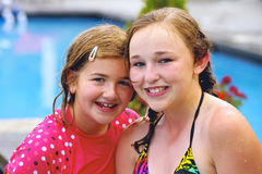 Young Girls Smiling at Pool Side stock photography