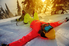 Young girls snowboarders enjoy in winter Royalty Free Stock Photo
