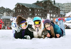 Young girls are snowboarders in mountains Stock Photo