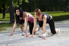 Young girls in sprinting position Stock Photography