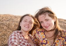 Young girls on the stubble Stock Photo