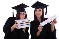 Young girls in student mantle with diploma and books Royalty Free Stock Photo