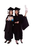 Young girls in student mantle with diploma and books Royalty Free Stock Images