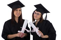 Young girls in student mantle with diploma Stock Images