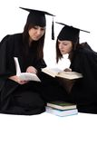 Young girls in student mantle with stack of books Stock Image
