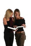 Young girls studying Stock Images