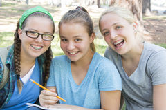 Young Girls Studying Stock Photography