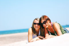 Young girls on the summer beach Stock Images