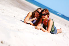 Young girls on the summer beach Stock Image