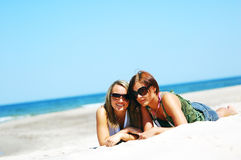 Young girls on the summer beach Royalty Free Stock Image