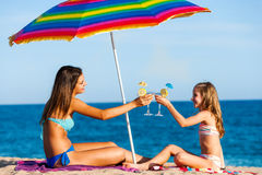Young girls on summer holiday with cocktails. Royalty Free Stock Images