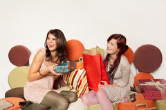 Women surprised with gifts Stock Image