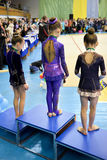 Young girls take part in gymnastics competition Stock Image