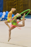 Young girls take part in gymnastics competition Royalty Free Stock Photo