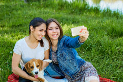 Young girls taking photo of herself and her dog outdoor in natu Stock Photography