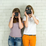 Young girls taking picture Stock Photography