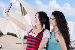 Young girls taking a selfie at Opera House Royalty Free Stock Photo