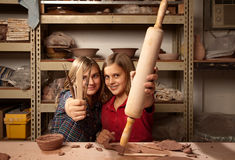Young girls with tools in clay studio Stock Photo