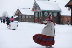 young girls in traditional costumes of the Russian north in wint stock photography
