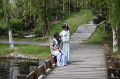 Young girls in traditional dress. Two young Chinese girls in traditional dress on a bridge preparing for May festival. Photo taken May 2014 Stock Photography