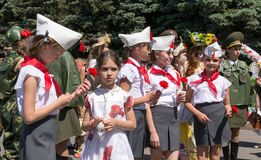 Young Girls in traditional Russian communist and Red Army Uniforms Stock Image