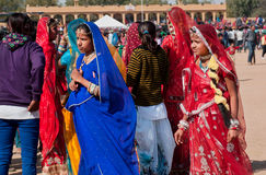 Young girls in traditional saris walking. JAISALMER, INDIA: Group of young girls in traditional saris walking on the popular Desert Festival. Every winter Stock Images